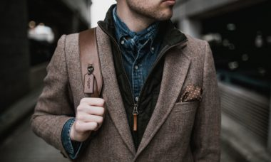 well dressed man carrying leather bag